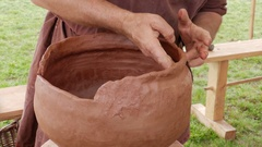 Potter kneading a bowl made of clay Stock Footage