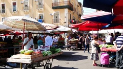 Catania, Italy  seller of fruits and vegetables at a market street Stock Footage