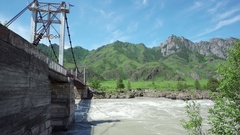 Suspension bridge over Katun river in Altay, Russia. Stock Footage