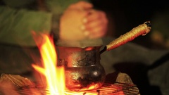 Waiting Hot Coffee  near  bonfire, Travel team. Stock Footage