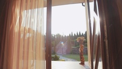 Bright morning sunshine in the doors entrance when two siblings, brother and Stock Footage