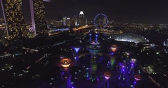 Aerial night view of Supertree and Marina Bay Sands in Singapore from drone. Stock Footage