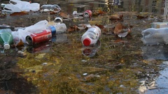 Waste plastics in the water Stock Footage