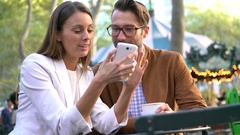 Couple having a date at Bryant Park, Manhattan Stock Footage