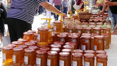 Farmers Market. Jars of honey for sale Stock Footage