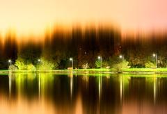 Dramatic night park illumination reflections background Stock Photos