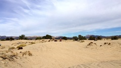 Sand dunes-several dirt bikes riding and jumping HD Stock Footage