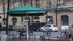 Starbucks coffee shop cafe umbrella, street in Berlin, Germany Stock Footage