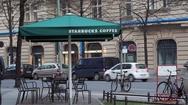 Starbucks coffee shop cafe umbrella, street in Berlin, Germany Stock Footage