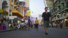 Tourists walking at Khao San Road, a popular destination of Bangkok for tourists Stock Footage