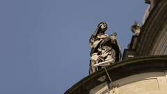 Dominican church in Lviv. Antique statue close up. Sunny day and bllue sky with Stock Footage