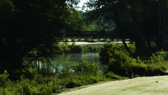 River Through Golf Course Stock Footage