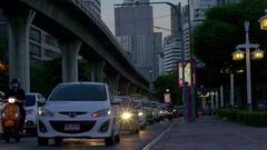 Evening traffic at the Ratchadamri Rd street near SiLom metro station at Thanon Stock Footage