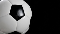 Soccer ball or football bright studio on a black Stock Footage