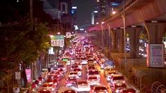 View of night city traffic at Sathon Tai Road, Bangkok, Thailand Stock Footage