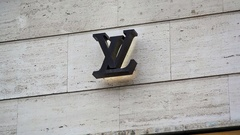 Louis Vuitton logo on shop, expensive fashion designer label, Berlin, Germany Stock Footage