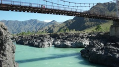 Tourists make selfie on the bridge over Katun river in Altay. Stock Footage