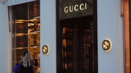 Women window shopping, Gucci expensive fashion shop, Kudamm street, Berlin Stock Footage