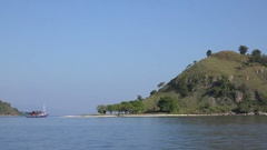 4k Small tropical island tourism spot by boat tour in the Flores Sea - Indonesia Stock Footage
