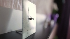 Creative  alarm clock on work table at home Stock Footage