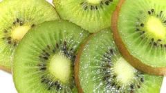 Kiwi fruit slice rotating Stock Footage