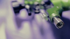 Extreme close up working tattoo machine Stock Footage