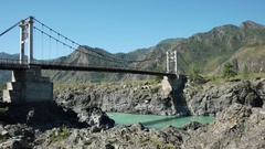 Car on the bridge over Katun river in Altay. Stock Footage