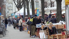 People shop and sell, flea market in Berlin park, Germany Stock Footage