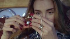 Girl unravels headphones Stock Footage