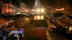 Established shot of Christmas Market with Ferris Wheel and lots of people Stock Footage