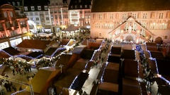 Aerial view drone elevation over Christmas Market with  people having fun Stock Footage