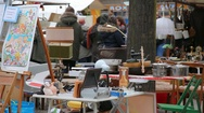 Flea market stand with many items for sale, Berlin, Germany Stock Footage