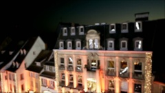 Aerial view flight over illumination street with Christmas Market lights and Stock Footage