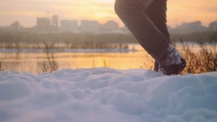 Man traveler trekking in wintertime cold snowy weather, men leg walking over Stock Footage