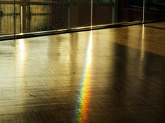 Rainbow effect seen on floor of public space Stock Footage