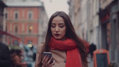 Amazing view of attractive young woman in a red scarf in the city center. Young Stock Footage