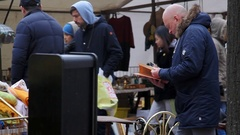 People shop and sell at Berlin flea market, Germany Stock Footage