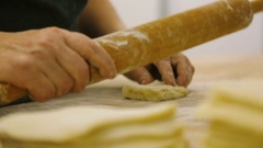 Kitchen worker prepares the dough for buns Stock Footage