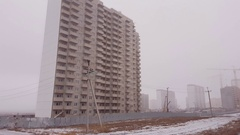 Construction crane and unfinished house in the fog. Stock Footage