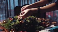 Crop hands making Christmas decor Stock Footage