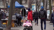 Man with baby stroller at a flea market, Berlin, Germany Stock Footage