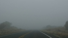 POV-Driving into dense fog Arizona desert US Highway 191 Stock Footage