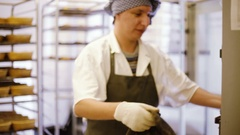 Chef takes hot bread from the oven Stock Footage