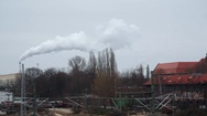 Industrial chimney white smoke, pollution in the city, Berlin, Germany Stock Footage
