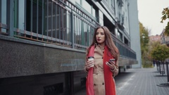Attractive young girl in an autumn coat and bright red scarf. Amazing business Stock Footage