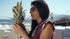 Beautiful young woman on a bar beach drinking fresh cocktail. Stock Footage