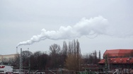 Pollution in the city, industrial white smoke chimney, Berlin, Germany Stock Footage