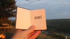 Travel idea. Book with the inscription Stock Footage