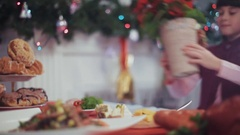 Cute girl with two ponytails helping mother to serve and decorate the Stock Footage