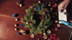 Person laying out natural ingredients for a wreath Stock Footage